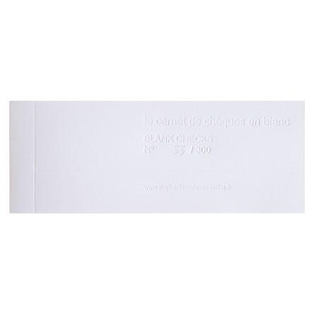 le carnet de chèques en blanc